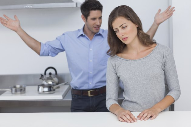 Man gesturing to wife during a dispute