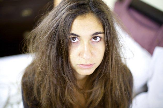 Sad and sick woman having really bad hair day