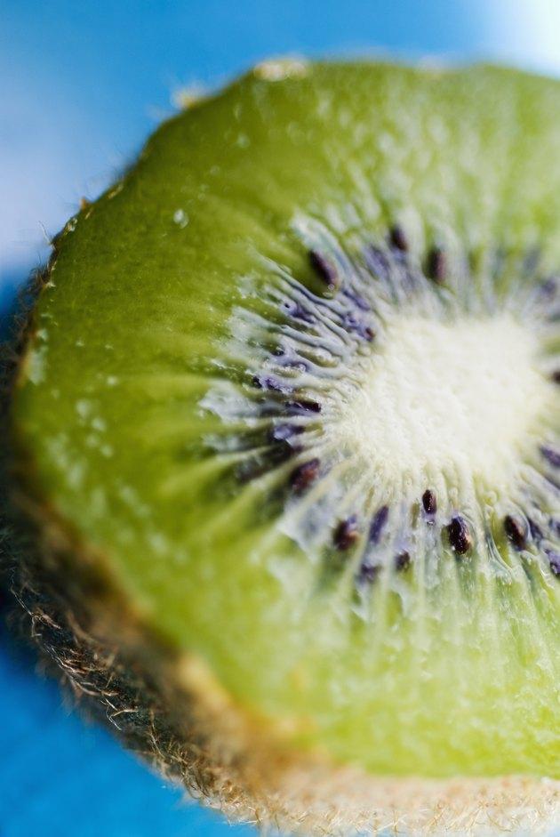 Close-up of a kiwi cut in half.