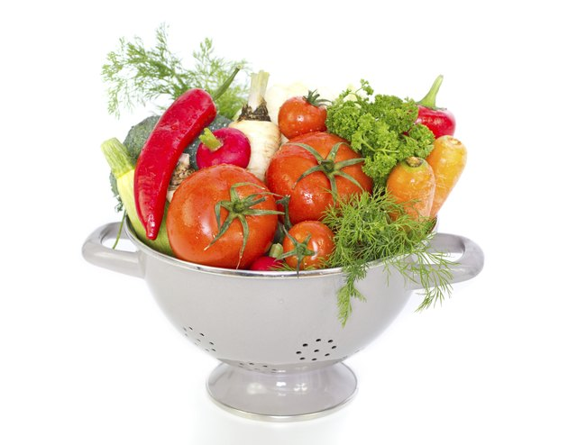 Fresh vegetables in metal colander