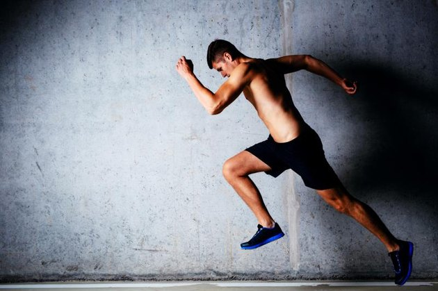 Runner sprinting against concrete wall