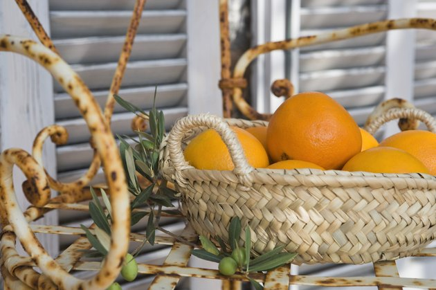 Basket of oranges on chair