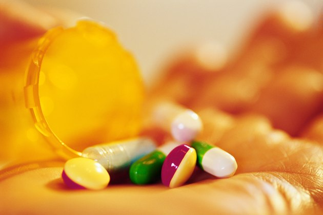 Bottle of pills in hand