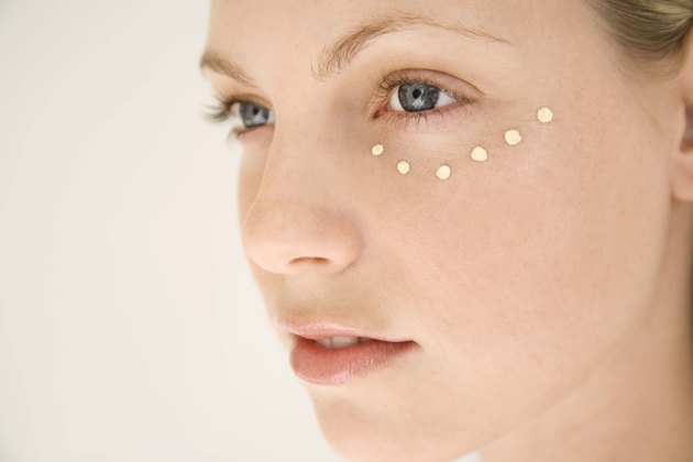Woman with dots of moisturizer