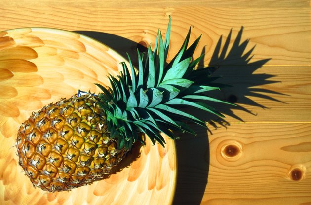Pineapple in basket, directly above