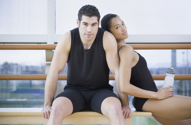 Male and female dancers in dance studio