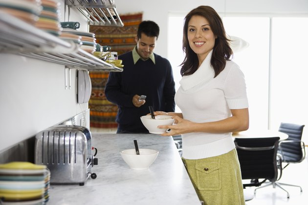 Young couple having breakfast in kitchen