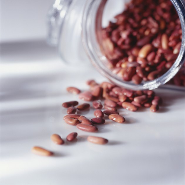 Beans spilled from jar, (Close-up)