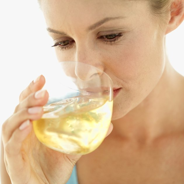 Close-up of a woman drinking from a glass