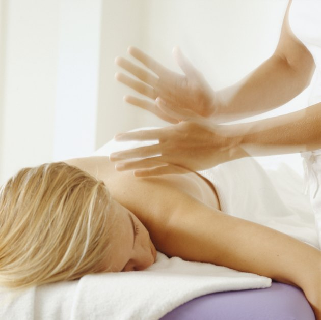 Young woman having back massage, close-up