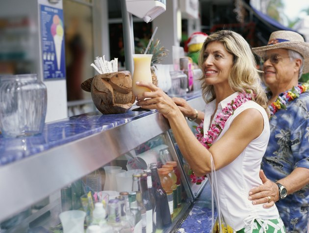 Side profile of a mature woman taking a milk shake