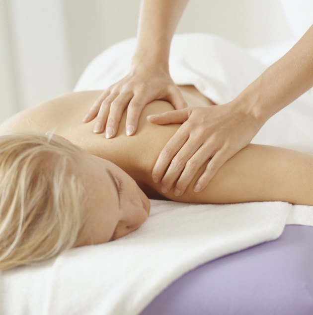 Young woman having massage, close-up