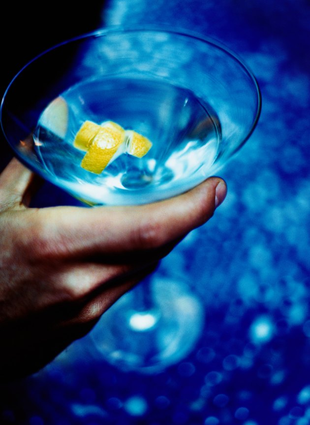 Hand Holding Martini with a Twist