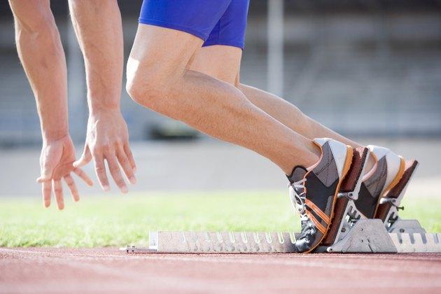 Athlete running out of starting blocks