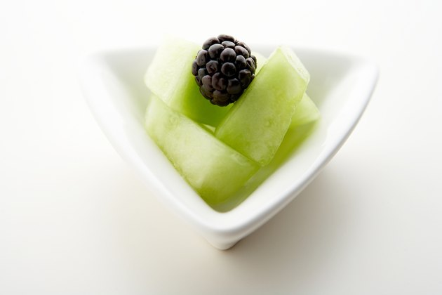 Blackberry on slices of honeydew