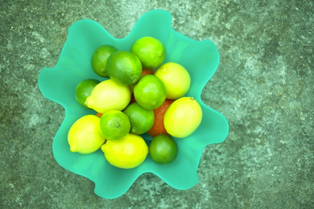Lemons and limes in bowl