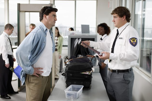 Security guard and man at airport
