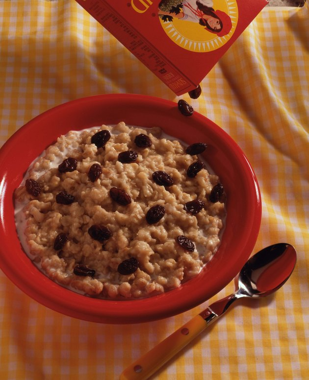 Raisins pouring over oatmeal