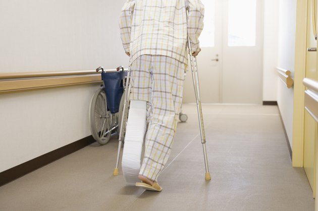 Patient walking with crutches in hospital