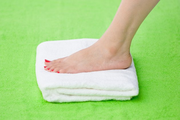Feet over towel