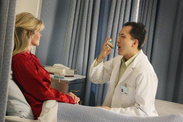 Doctor instructing patient with inhaler