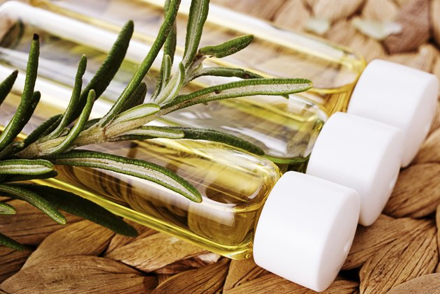 Organic oil with a sprig of rosemary closeup