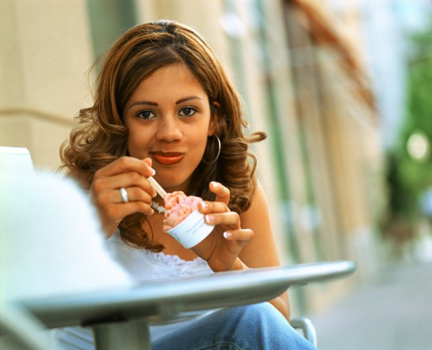 Hispanic woman eating ice cream