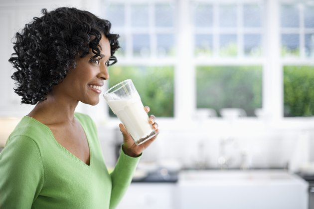Woman Drinking Glass of Milk