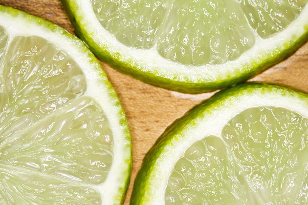 Sliced limes on wood cutting board