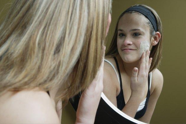 Applying facial moisturizer