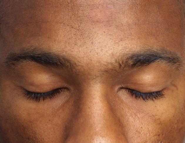 close-up of a man's eyes shut