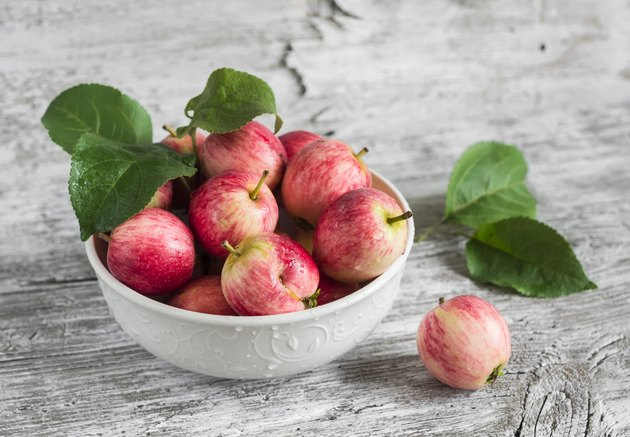 fresh red apples in a white bowl