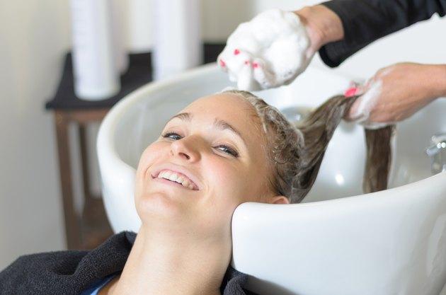 Woman having her hair shampooed
