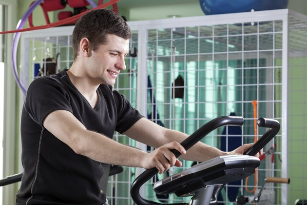 Man cycling on exercise bike