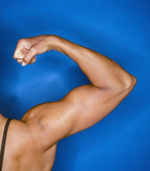 Bodybuilder's flexed right arm