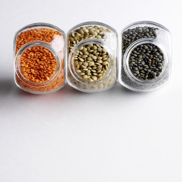 Colorful lentils in glass jars