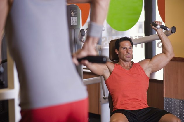 Men using exercise machines in gym