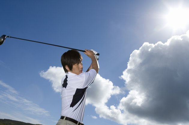 Man playing shot under the blue sky, lens flare, Saipan, USA