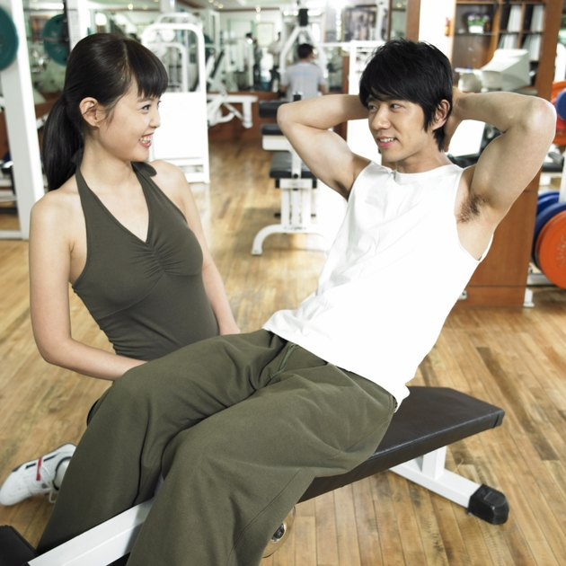 an exercising couple at a fitness club