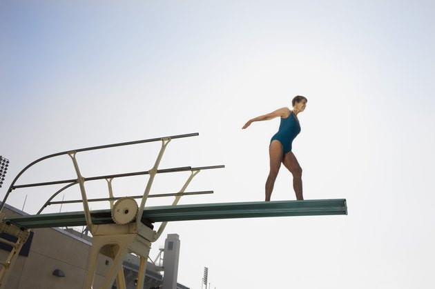 Senior woman on high diving board