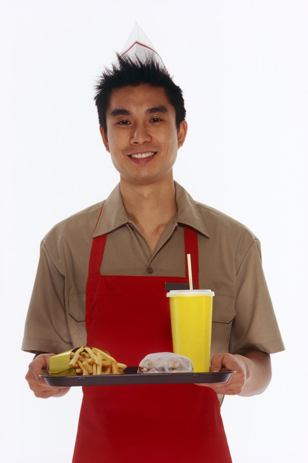 Fast food employee with tray