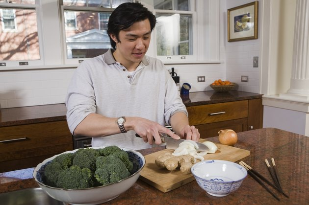 Man cutting vegetables in the kitchen