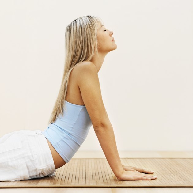 Side view of a woman doing yoga