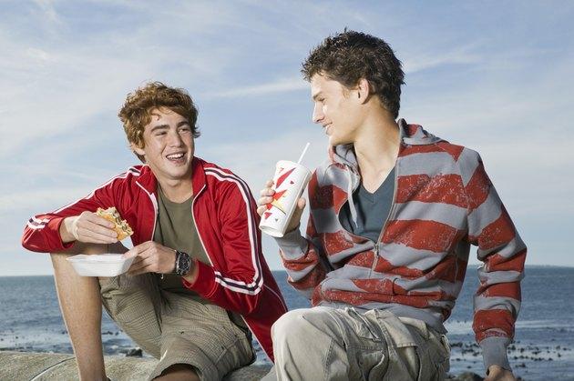 Teenage boys with fast food