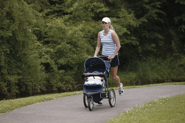 Woman jogging with baby in stroller