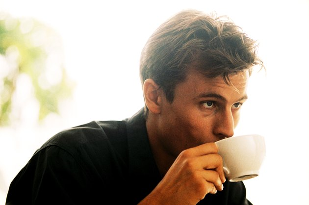 Young man drinking a cup of coffee
