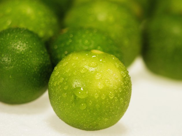Close-up of water drops on limes