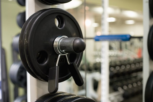 Weights on an exercise machine in gym, close up, differential focus
