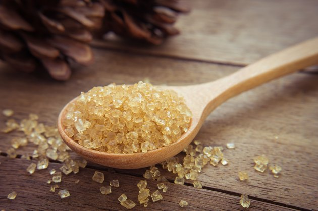 Brown sugar on wooden spoon