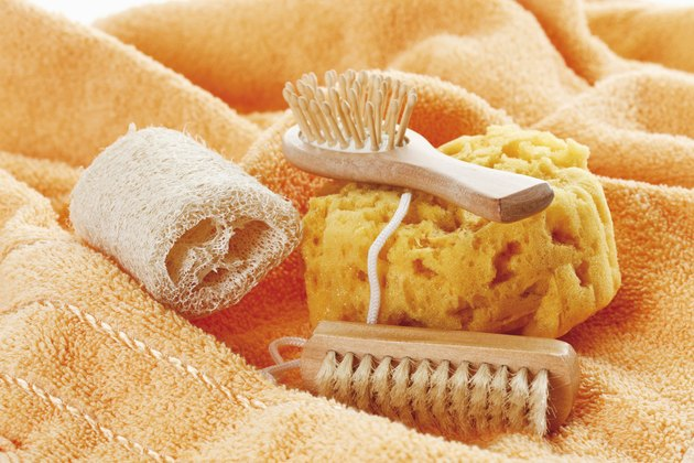 Variety of sponges and brushes on towel